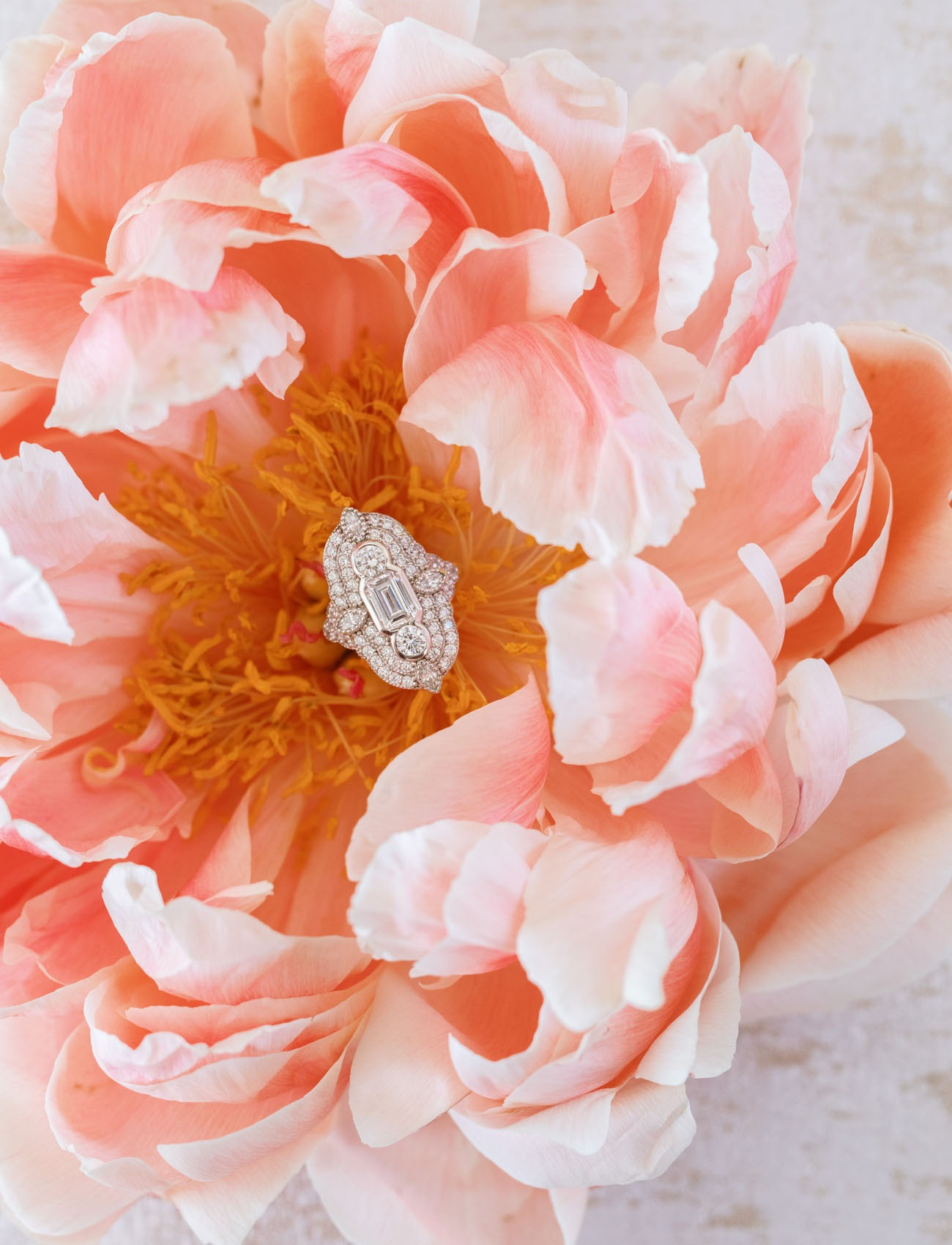 engagement ring sitting inside a blooming pink flower