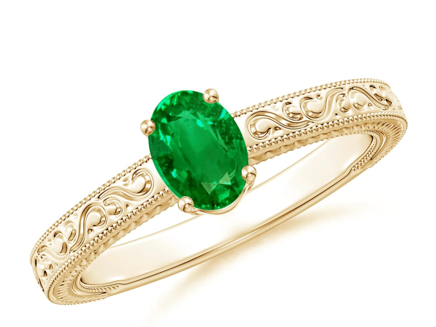 vintage inspired oval emerald engagement ring with delicate gold engraving details on the band