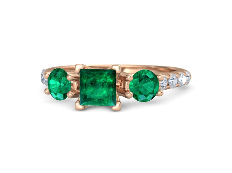 vivid green three stone emerald engagement ring with princess cut center stone