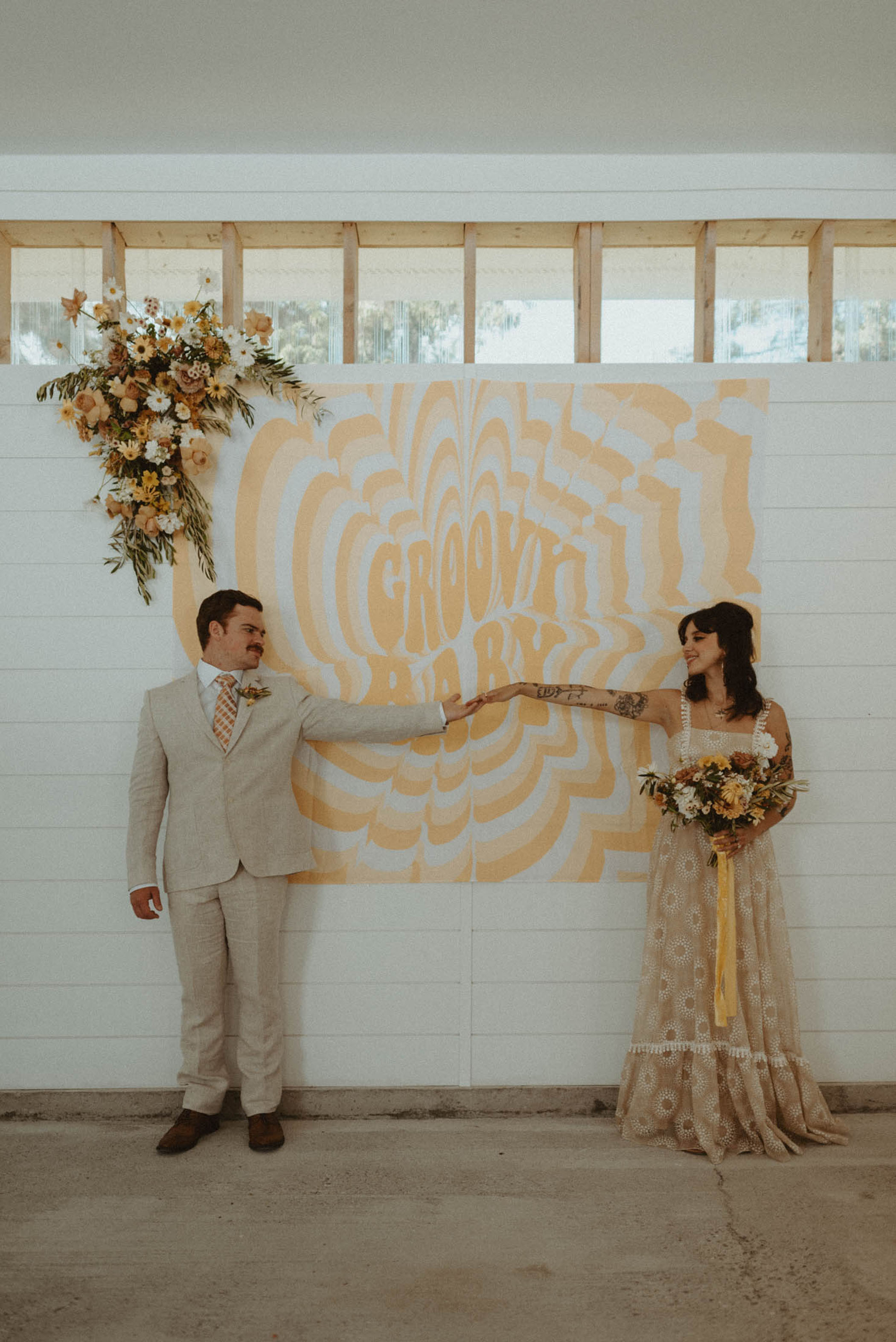This Retro-Inspired Elopement Features a Psychedelic Backdrop and Other Must-See 70s Themed Details