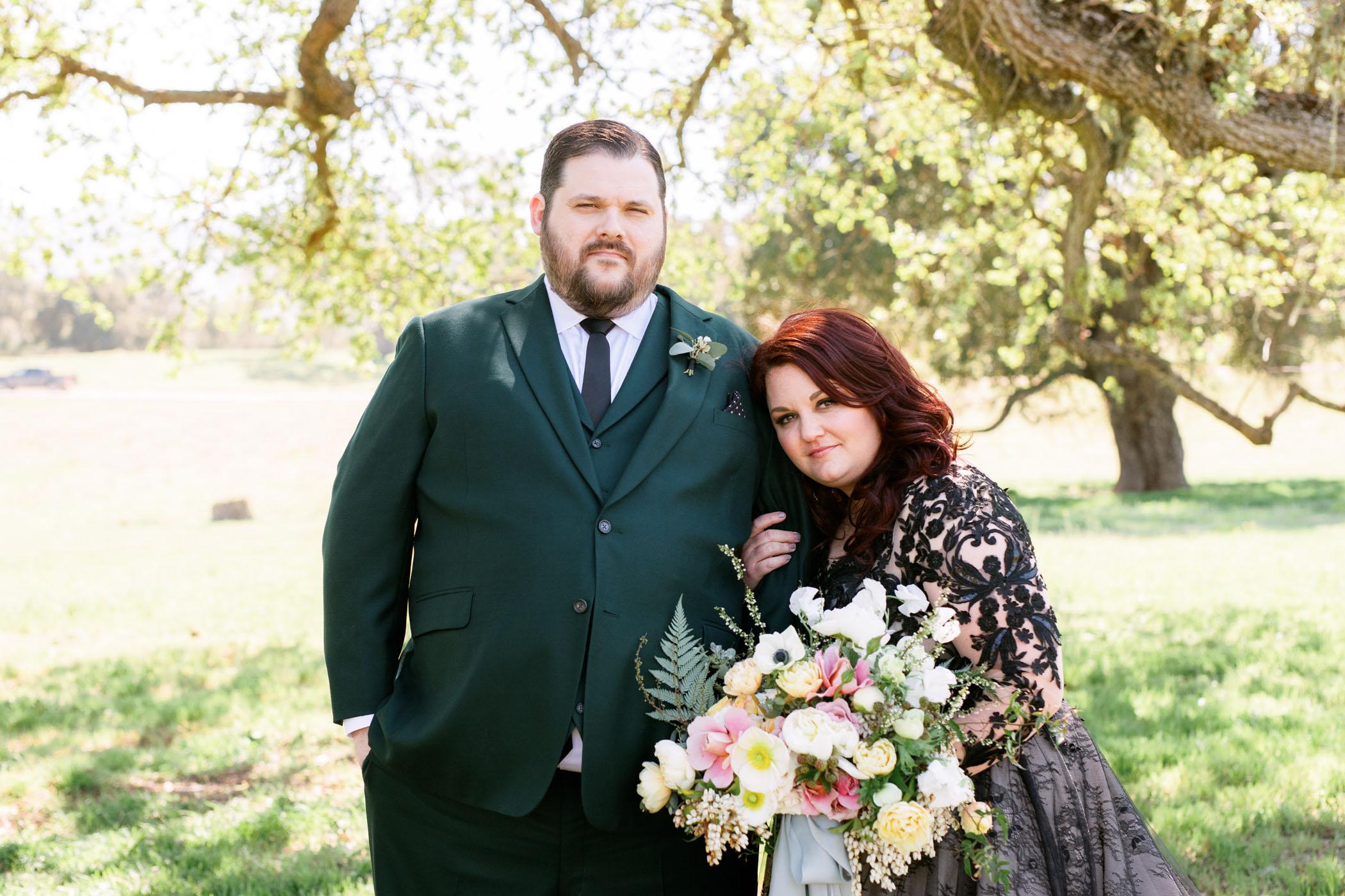 bride and groom black wedding dress