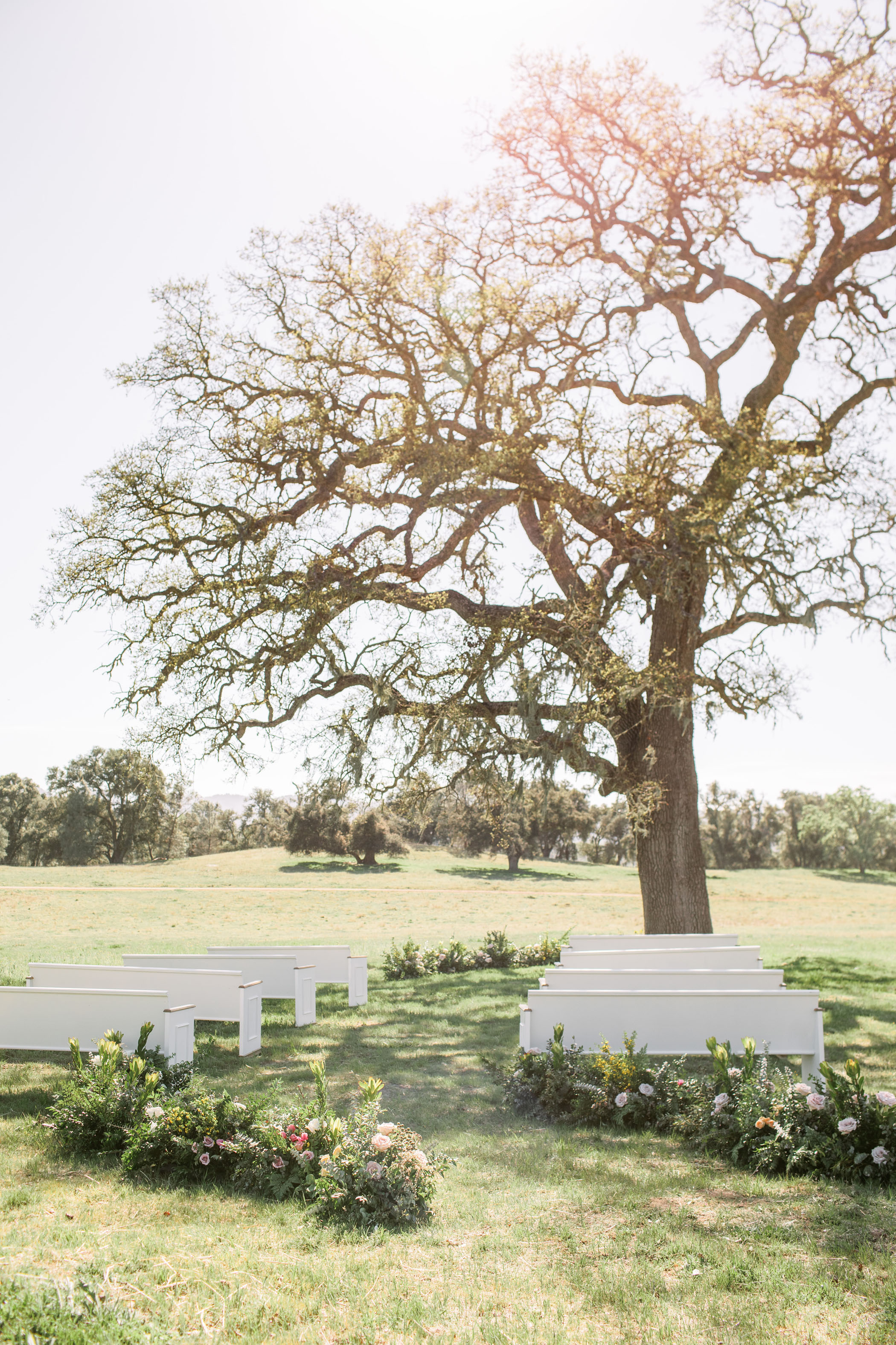 Intimate Wedding Ceremony with White Pews