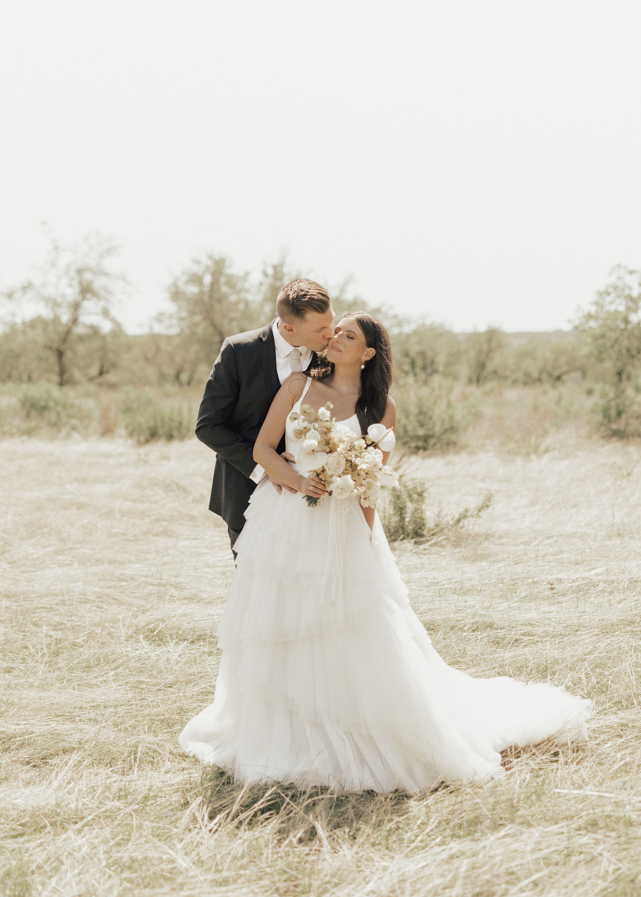 Modern Texas Wedding With Terracotta Neutrals + White Bridesmaids Dresses