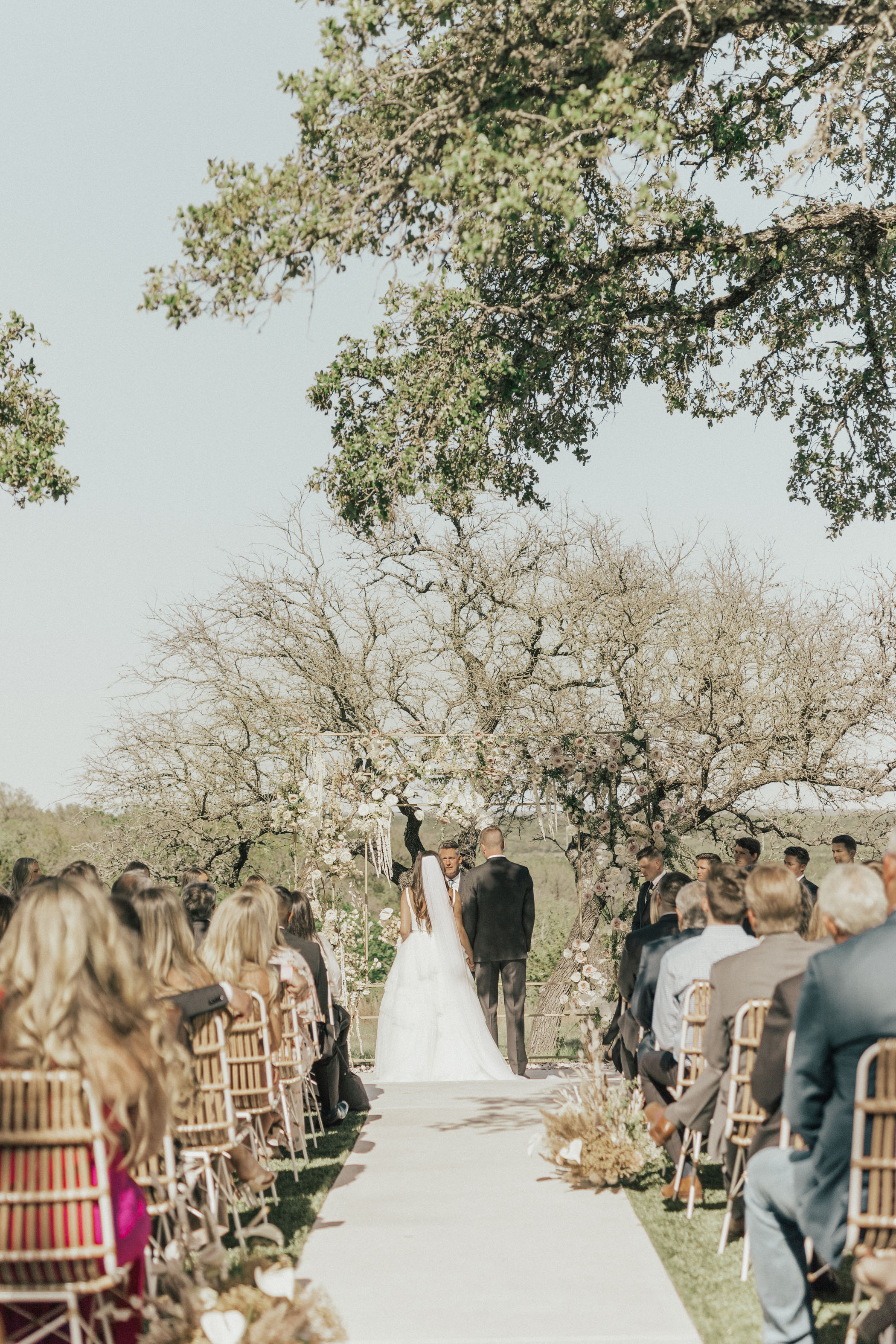 Texas Wedding with White Bridesmaid Dresses + Terracotta Details