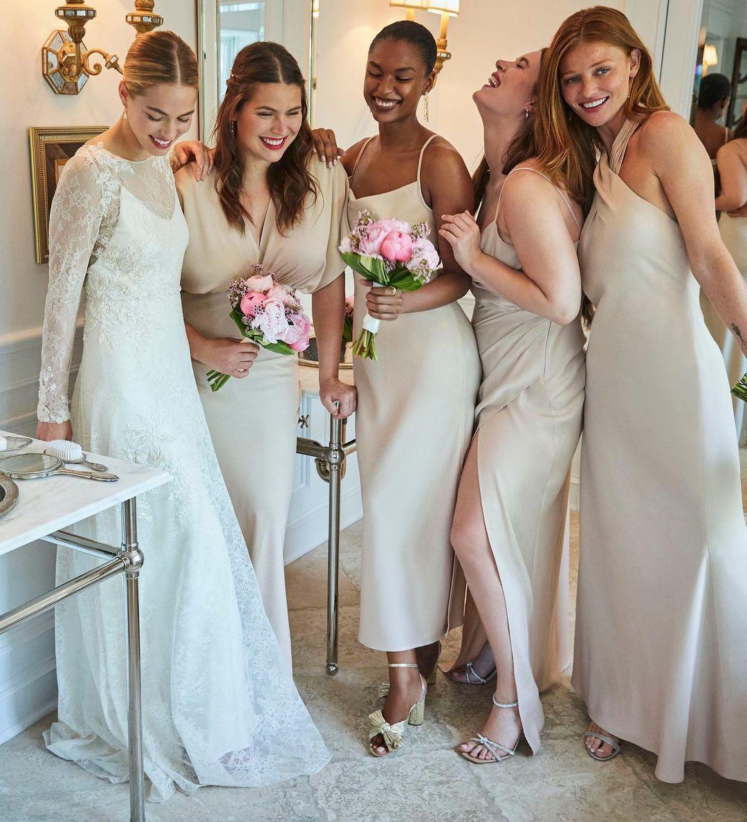 bhldn neutral bridesmaids laughing
