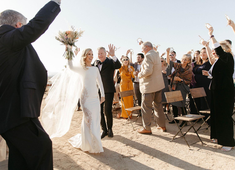 bride dances down wedding aisle