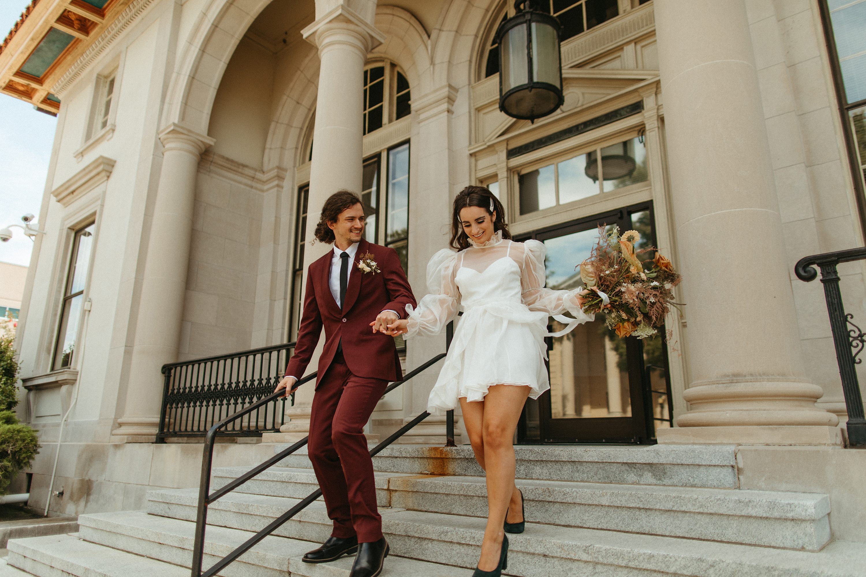newlyweds exciting the courthouse what to wear to a courthouse wedding short dress