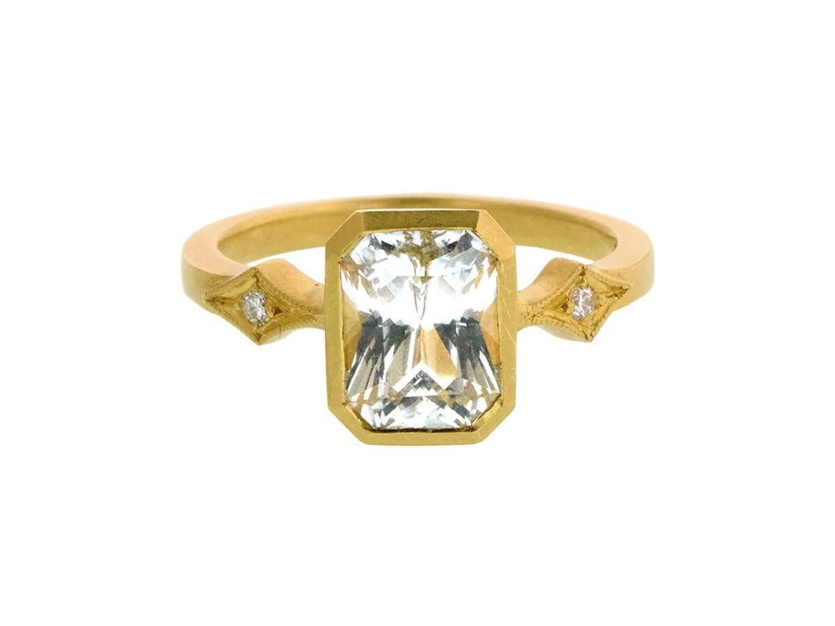22K yellow gold engagement ring with white sapphire stone in a bezel set
