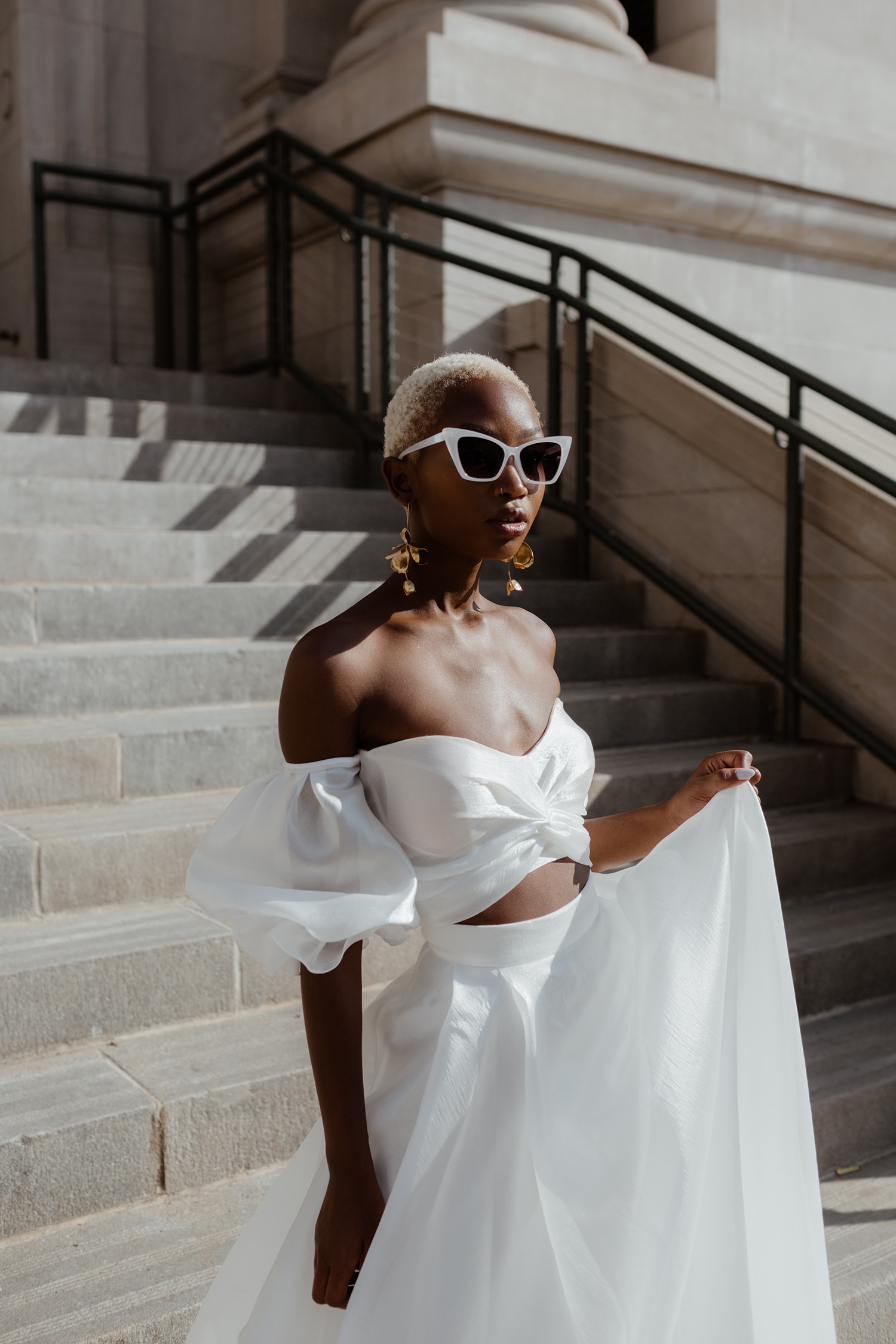 bride in two piece wedding dress and bridal glasses