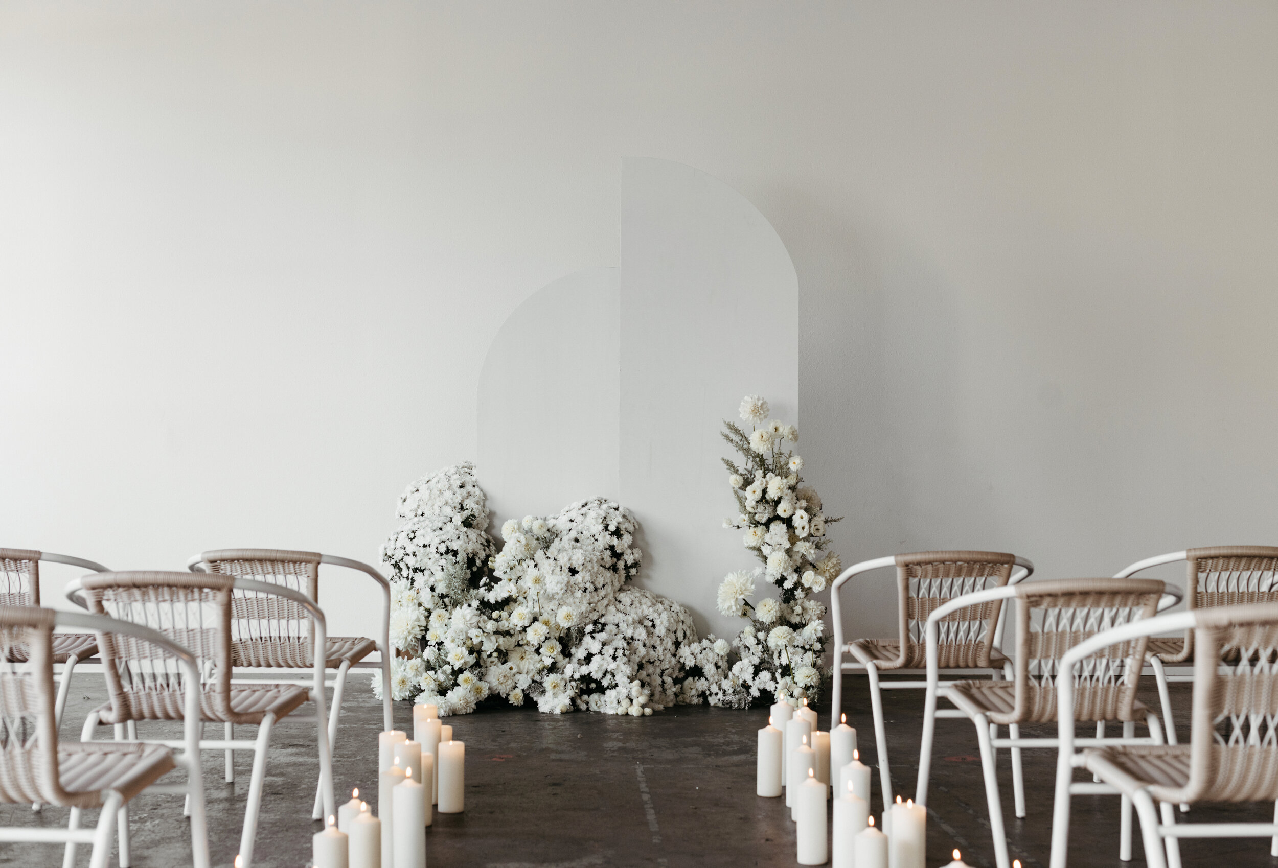 all white floral wedding backdrop