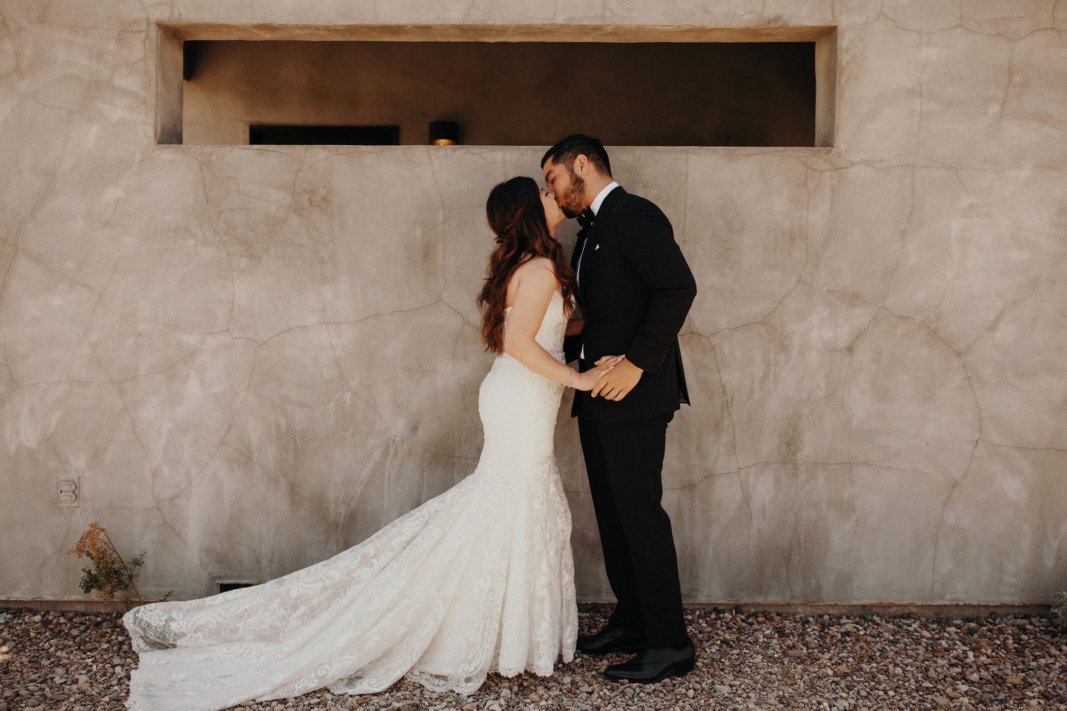 bride and groom kissing during their first look