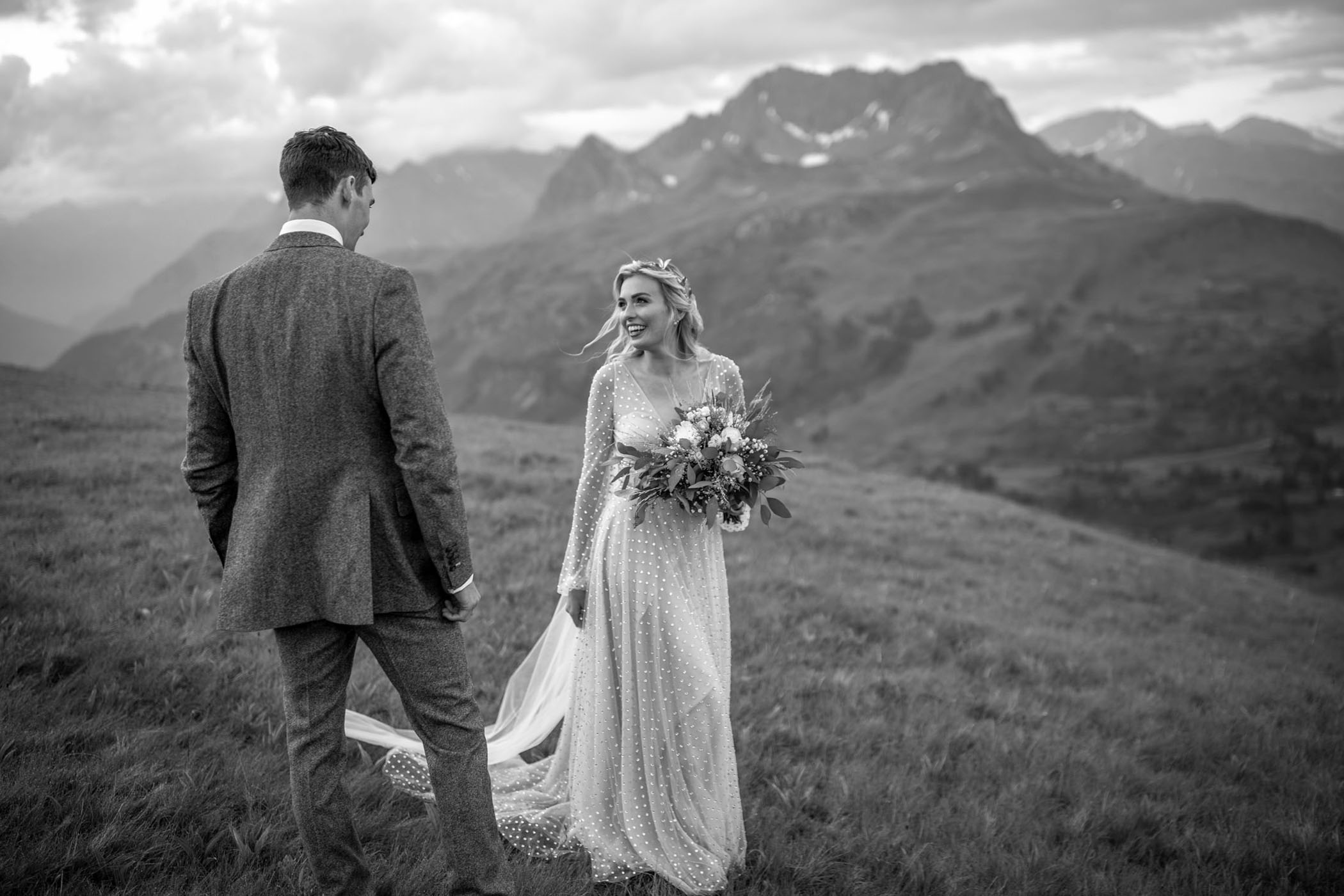 Bride stares lovingly at her groom as she approaches him