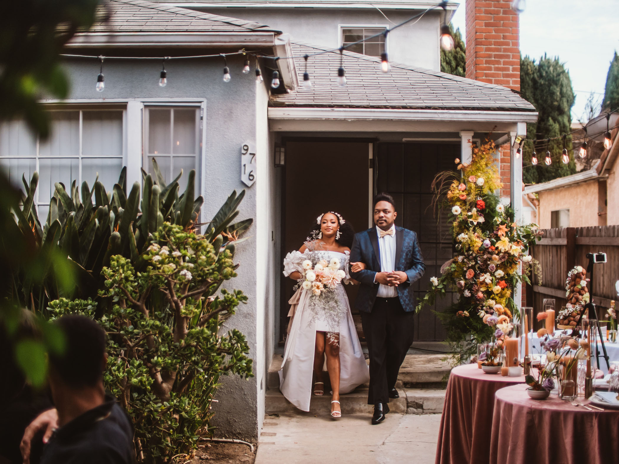 Bride being walked down the aisle for her backyard wedding