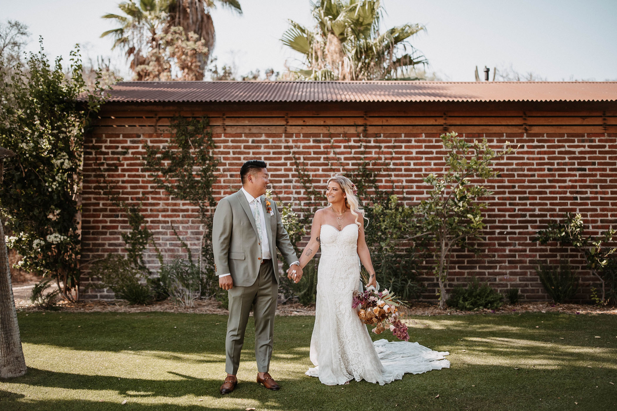Bride and groom holding hands at their wedding venue