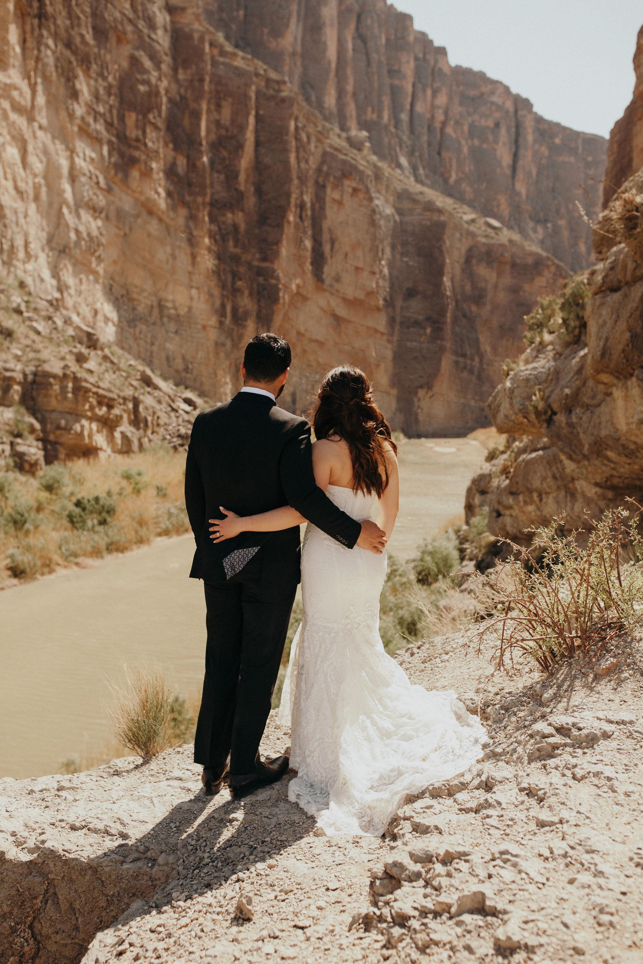 Bride and groom admiring the desert landscape