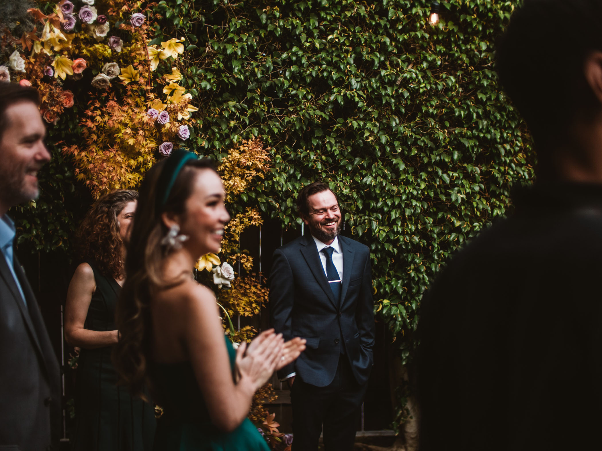 Husband smiling as he sees his bride for the first time