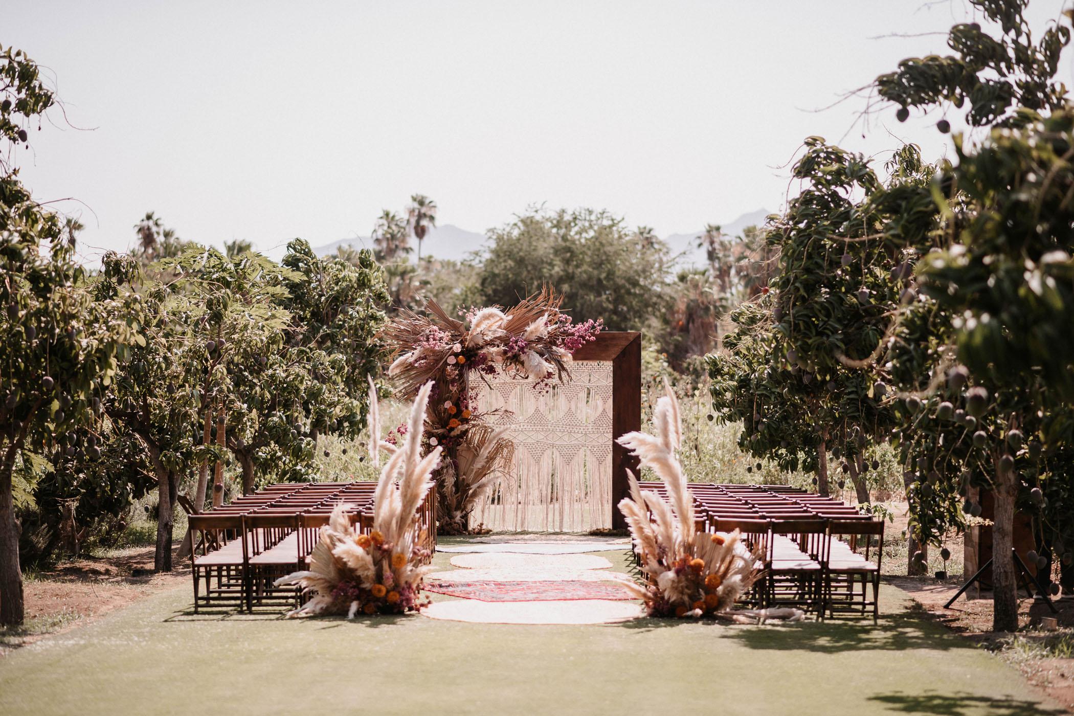 Pampas grass and macramé wedding ceremony setup