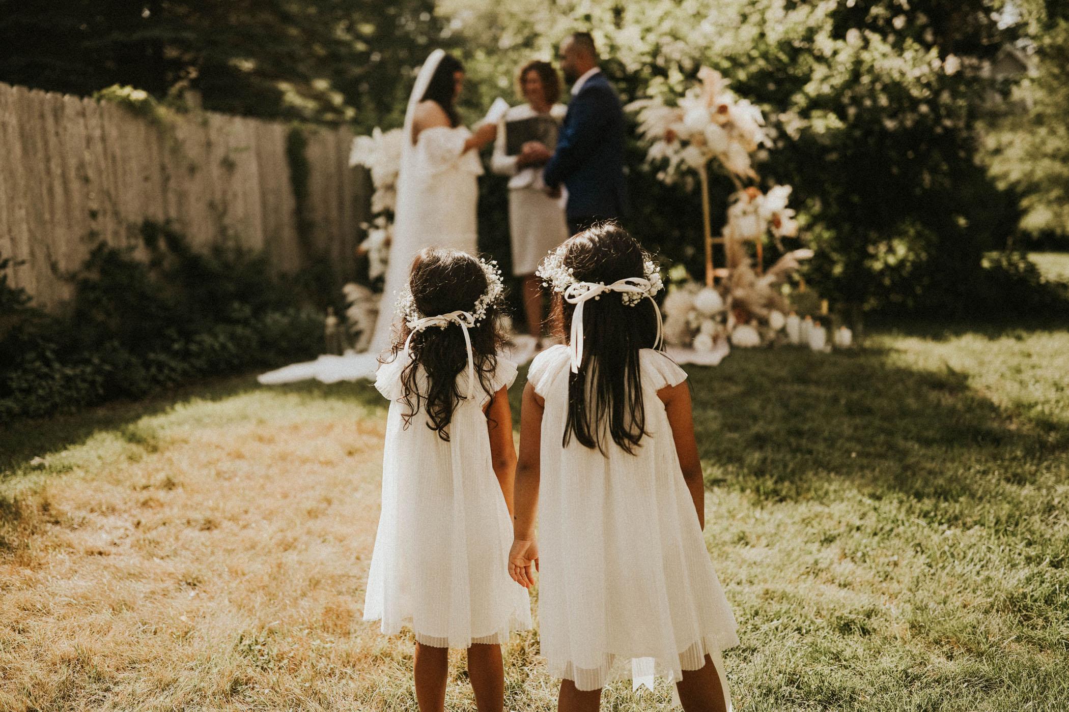 Flower girls watch their parent's elopement
