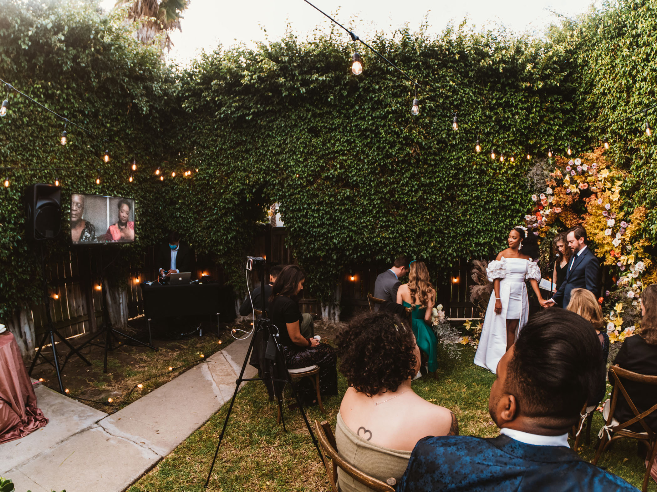 A family video plays during a wedding ceremony