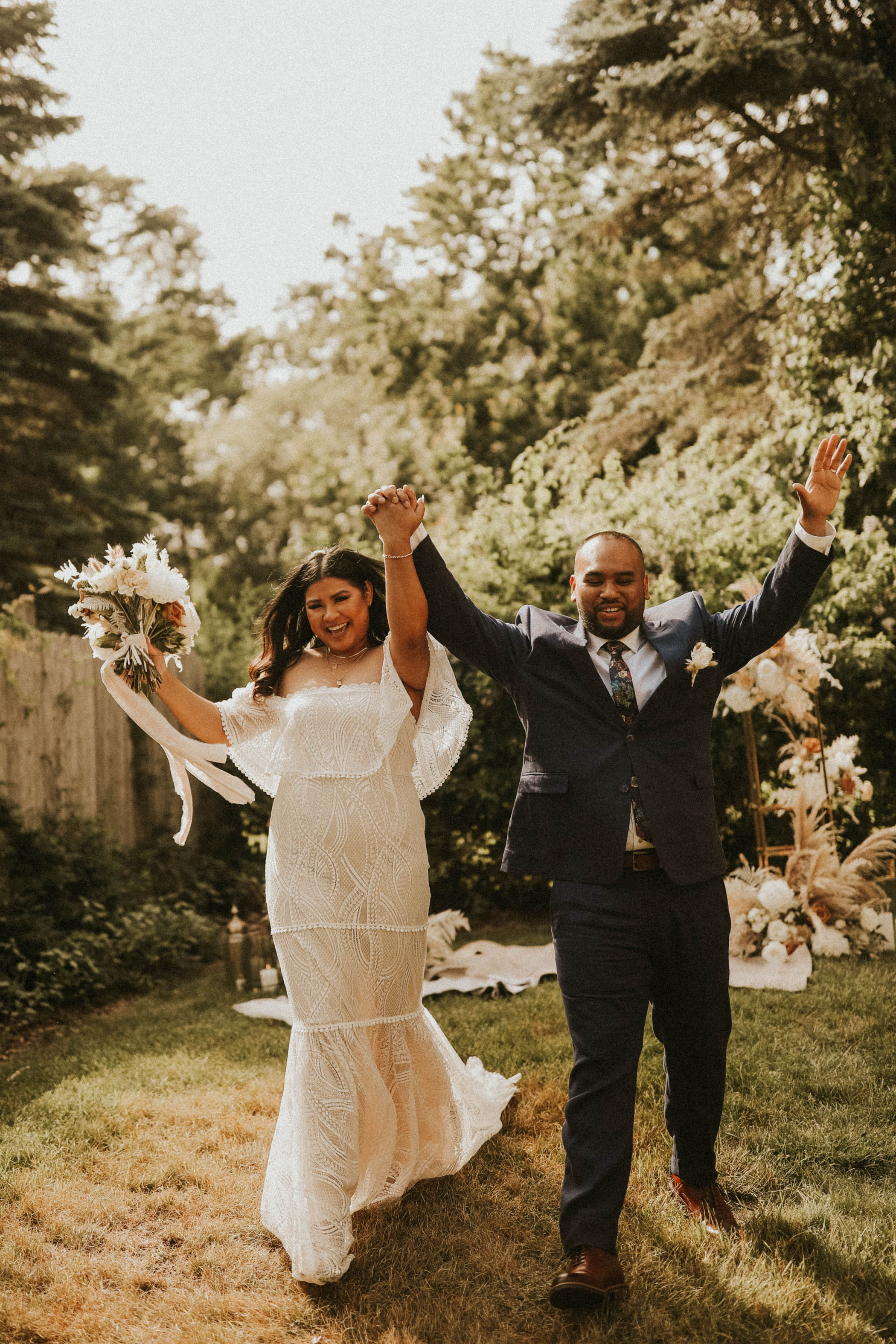 Married couple celebrate their backyard elopement