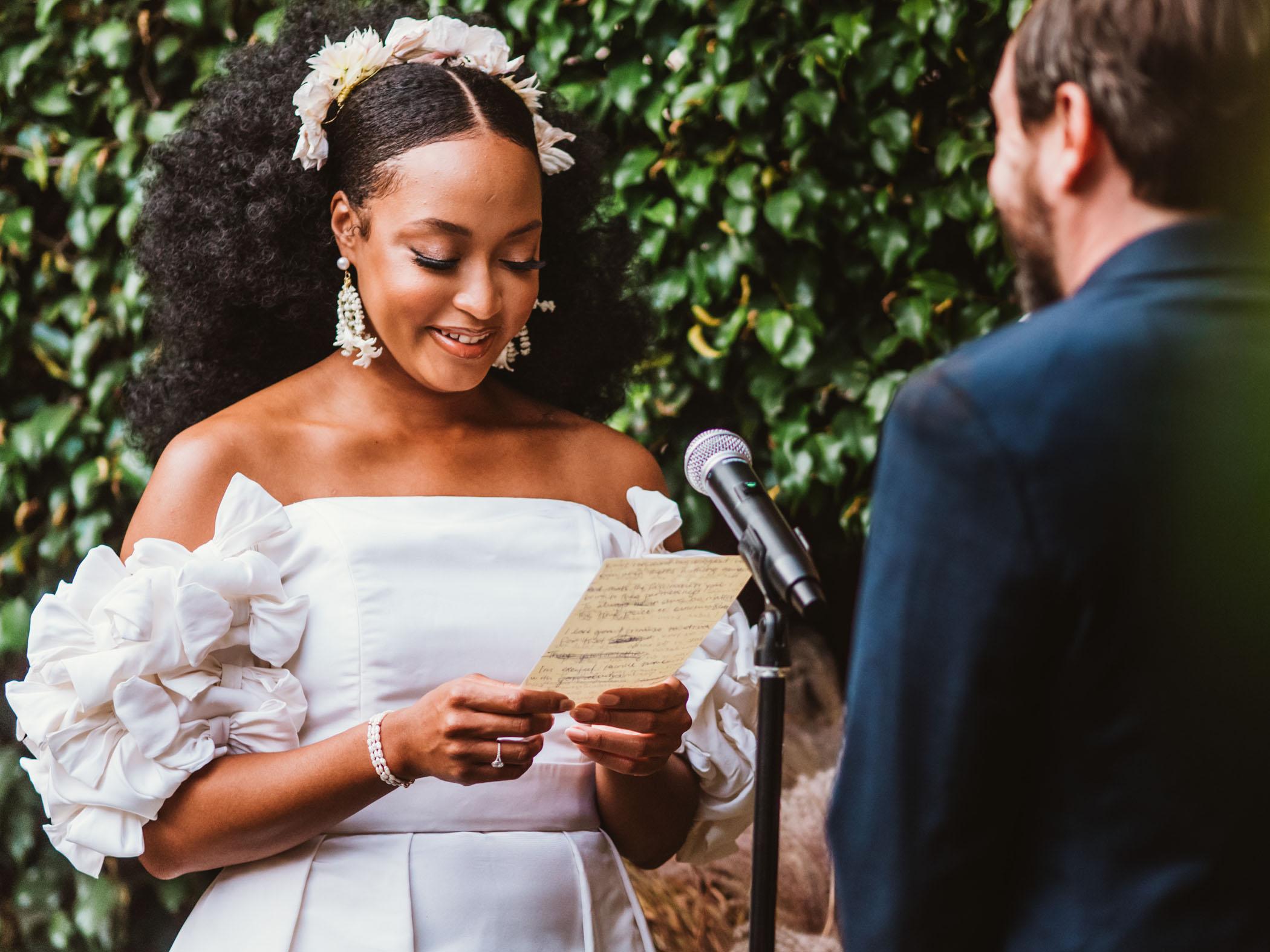 Bride reads her handwritten vows to her husband