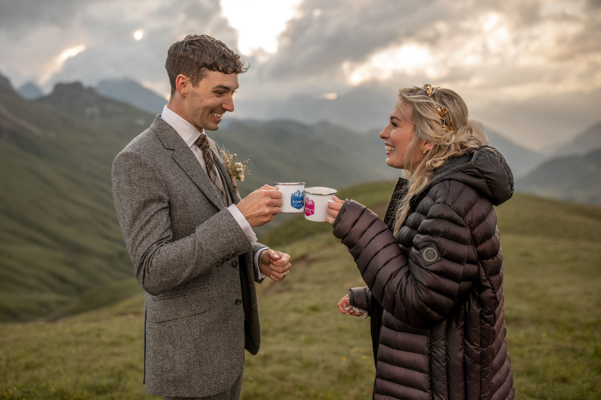 Bride and groom toasting with custom mugs on their wedding day