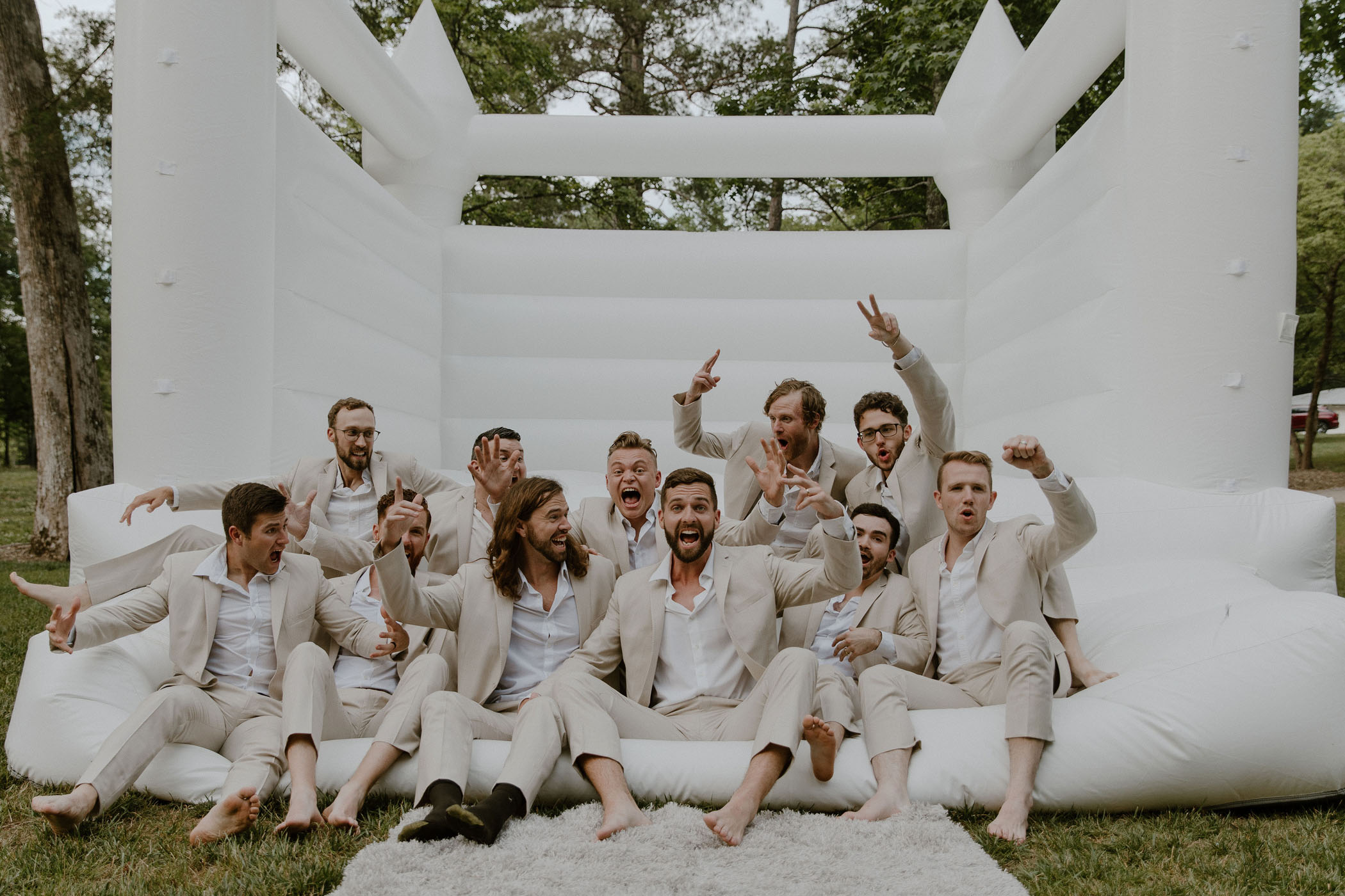Groomsmen in bounce house in the forest