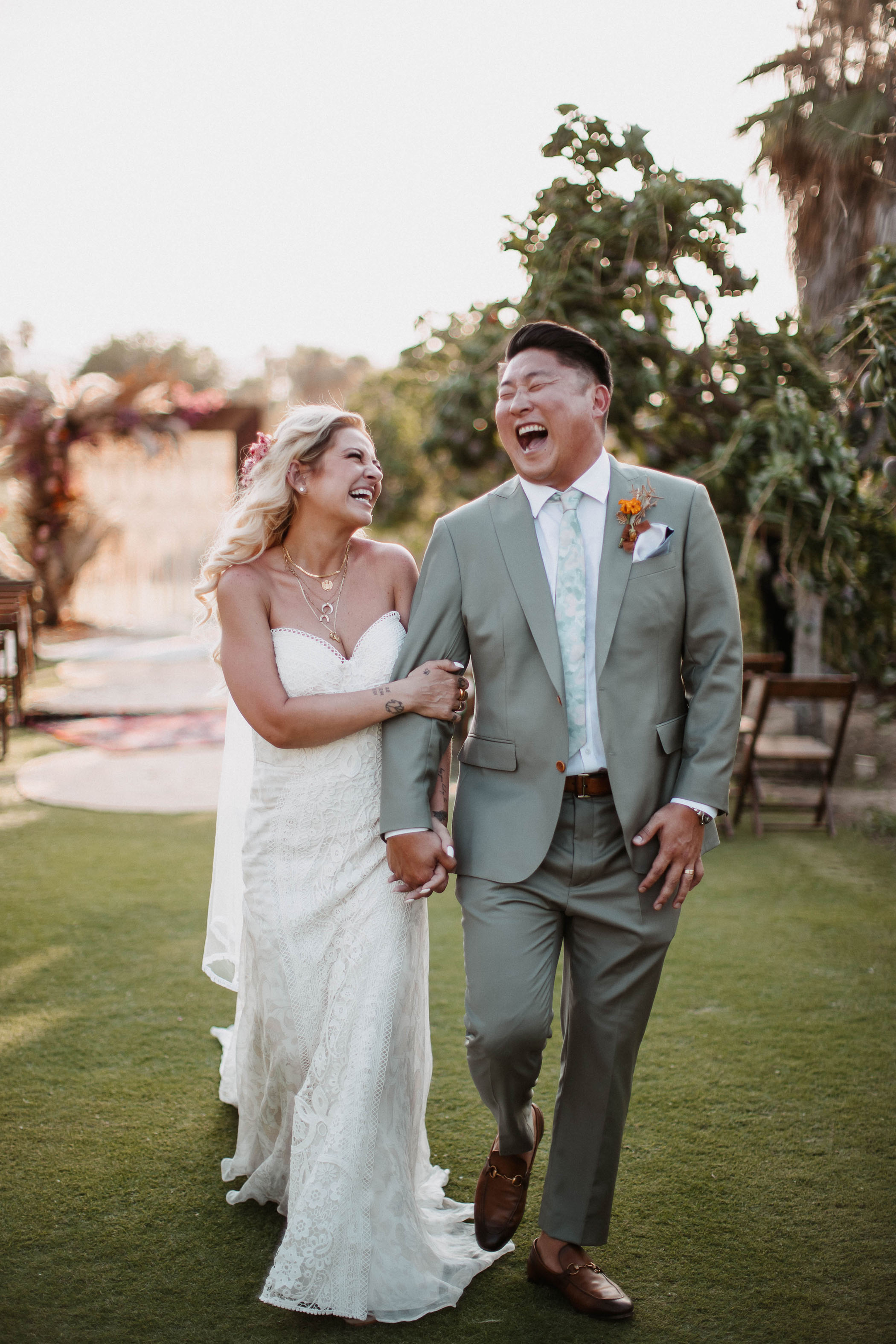 Husband and wife smiling and laughing after saying their wedding vows
