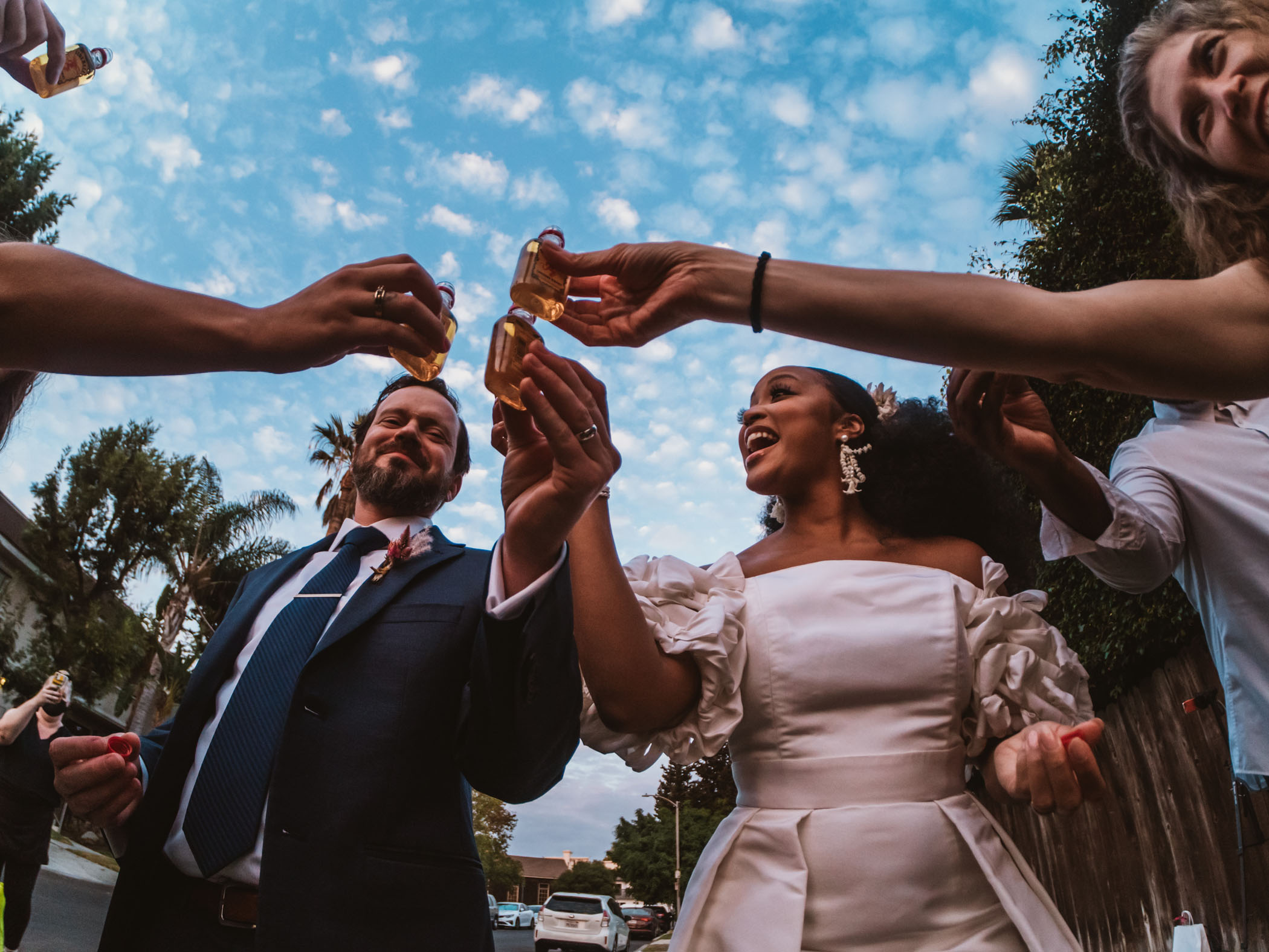Newlyweds and their guests take a shot together