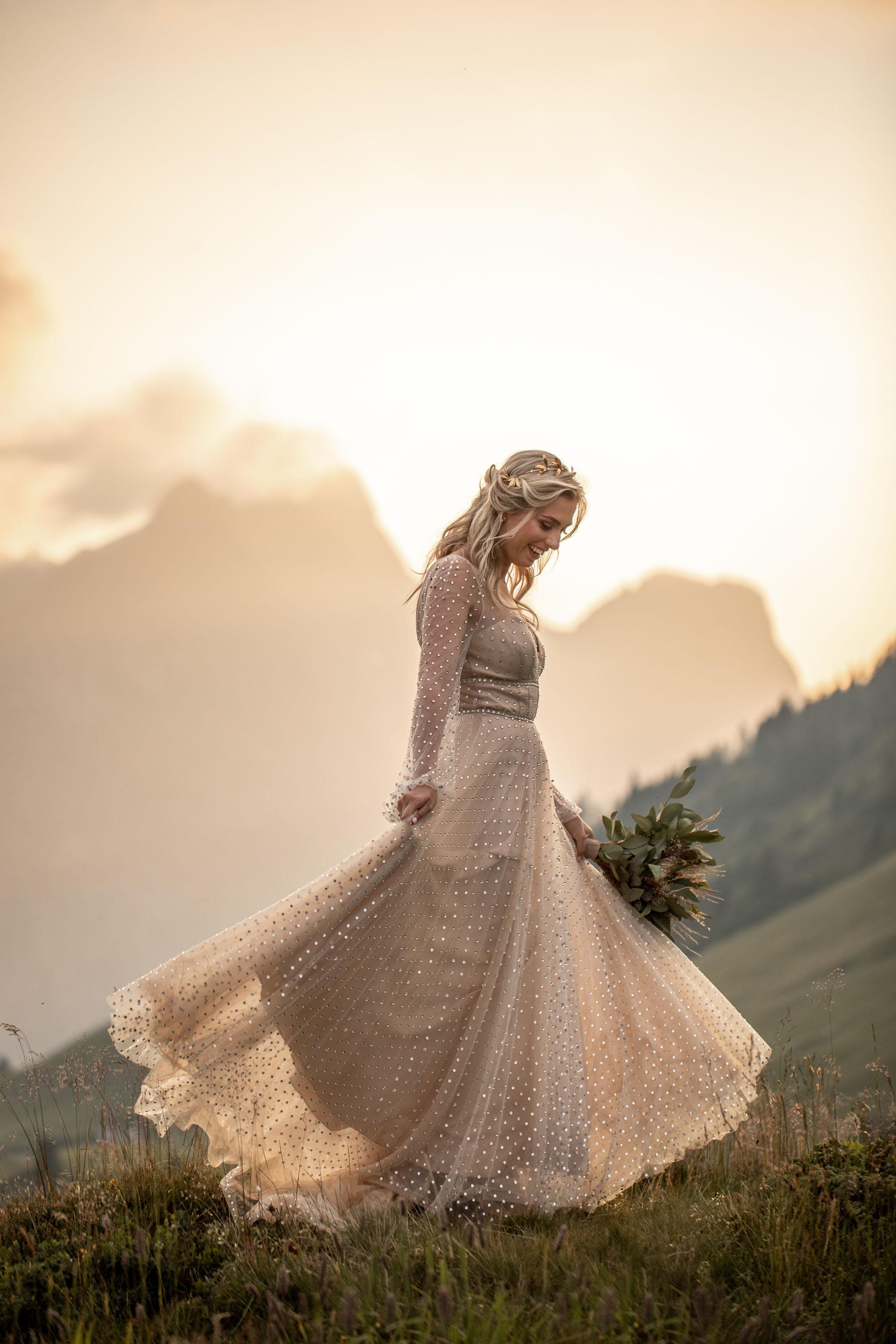 Bride twirls in 'Lunella' gown by Watters