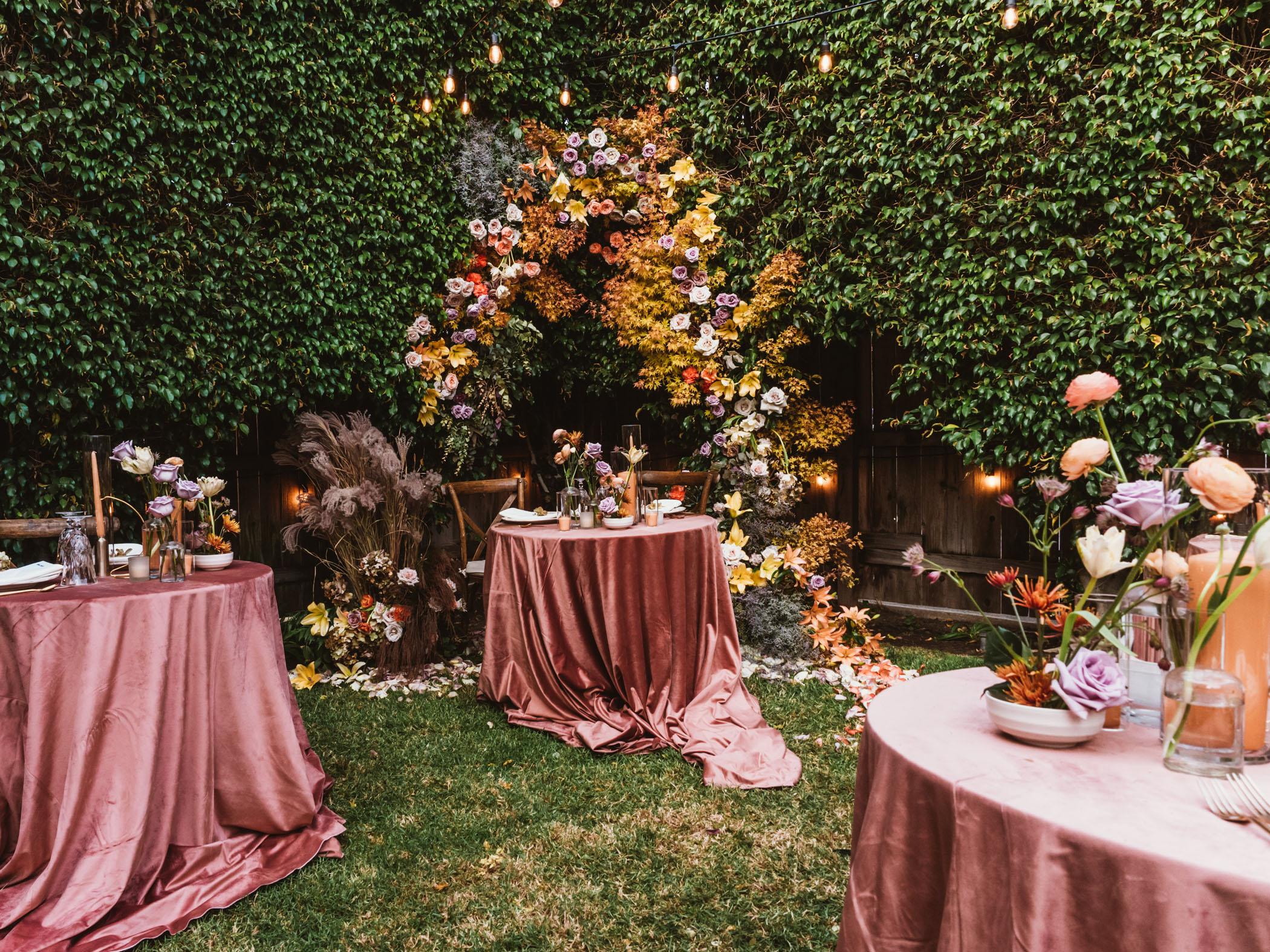 Pink draped wedding reception tables