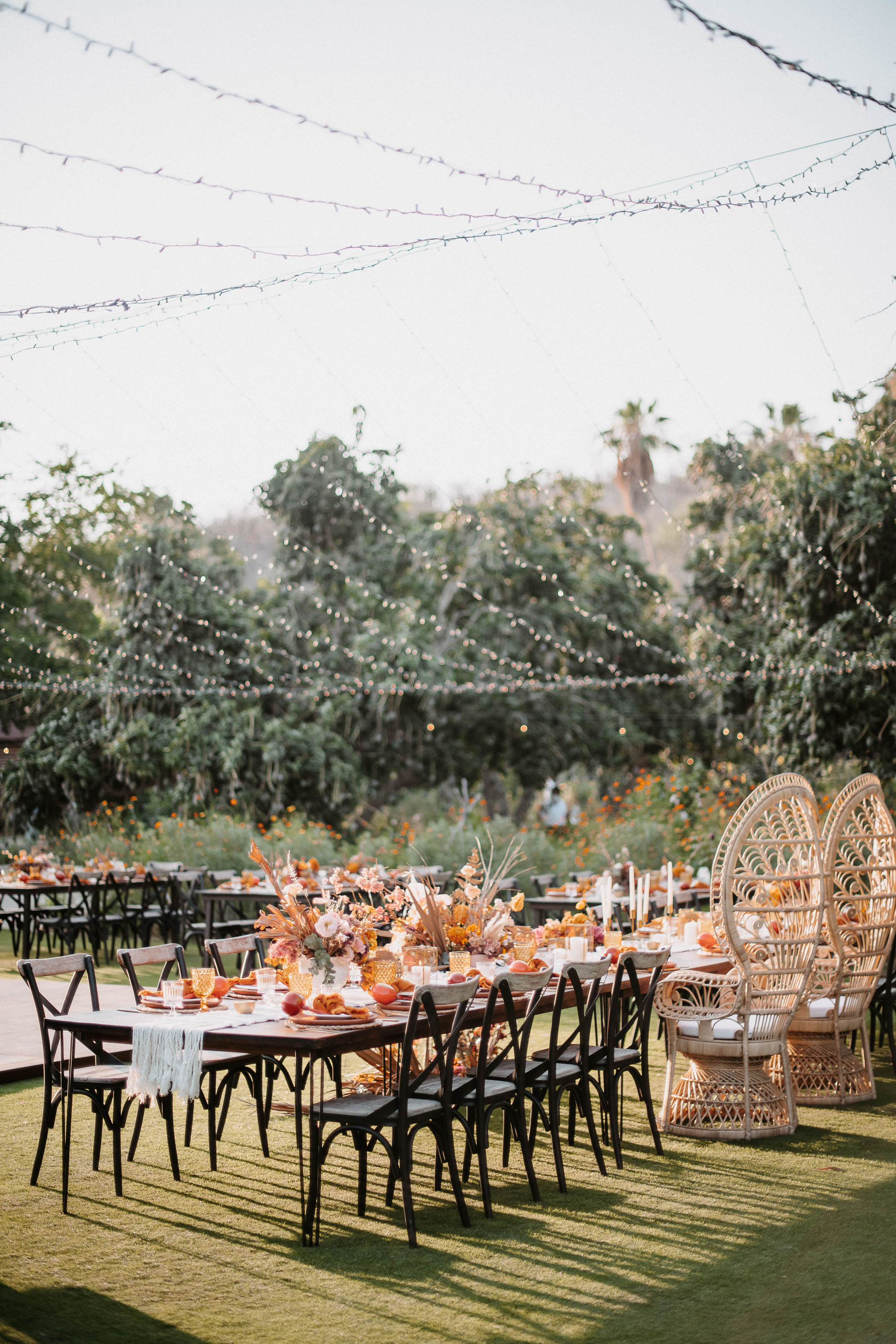 Wooden furniture and twinkle light wedding reception