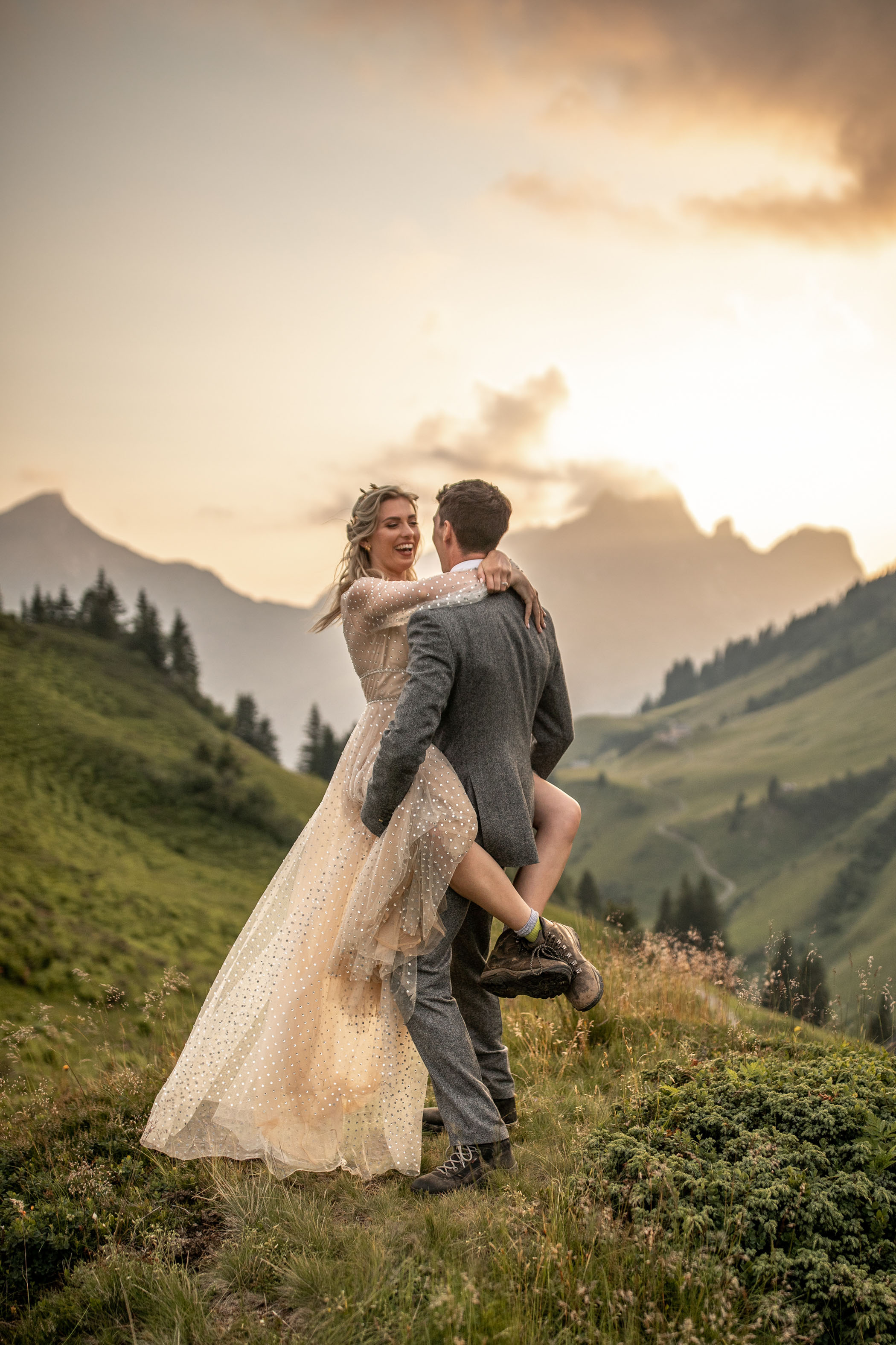 Adventurous bride and groom pose in their hiking boots