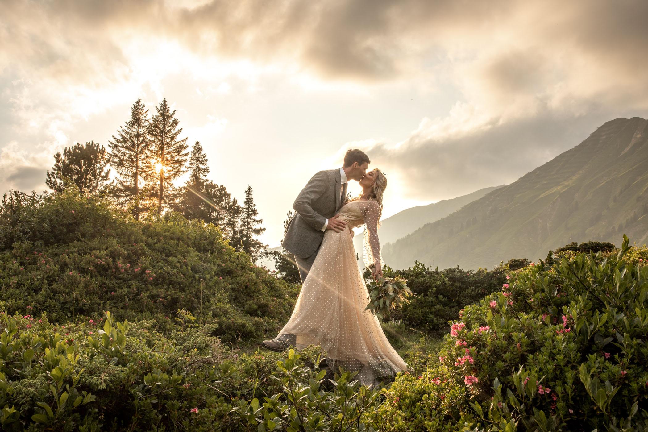 Austrian mountain top elopement kiss