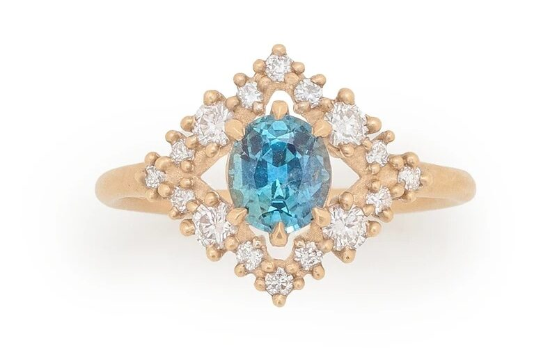 bohemian Montana blue sapphire engagement rings with diamond shaped halo surround