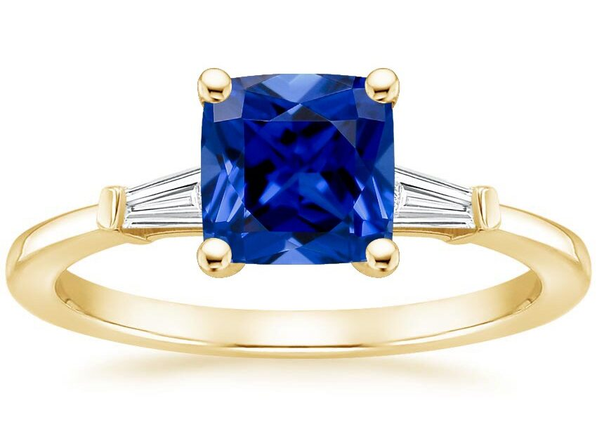cushion cut blue sapphire ring with tapered diamond baguettes