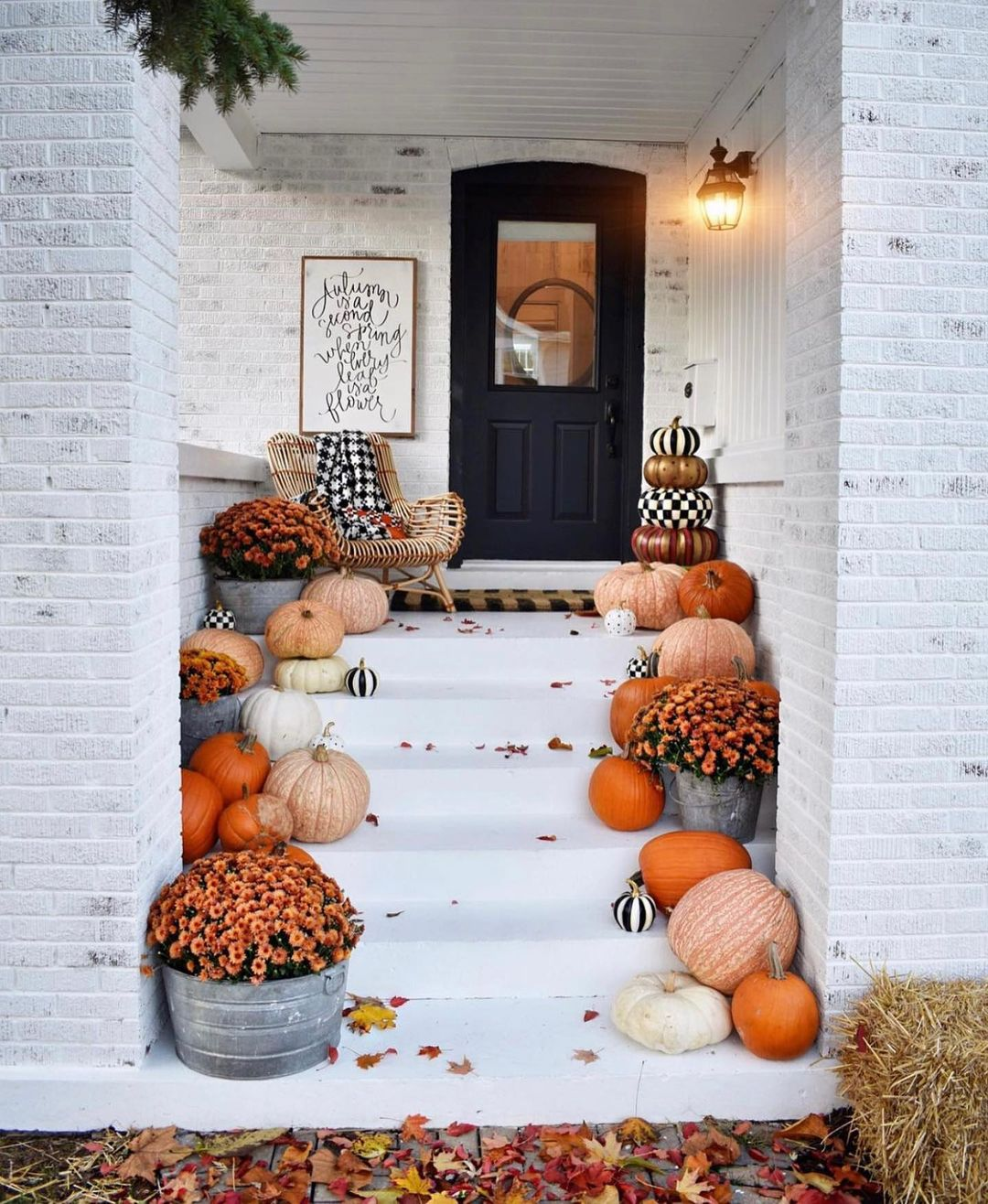 fall porch with pumpkins and gingham black door