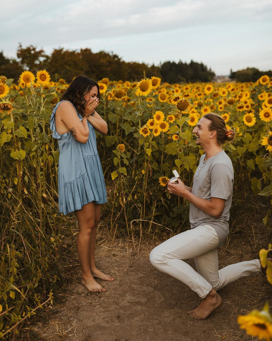 proposal ideas barefoot in a field of sunflowers