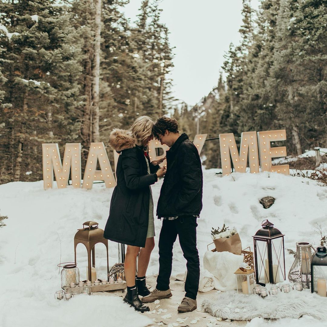 proposal ideas for the winter marry me marquee letters